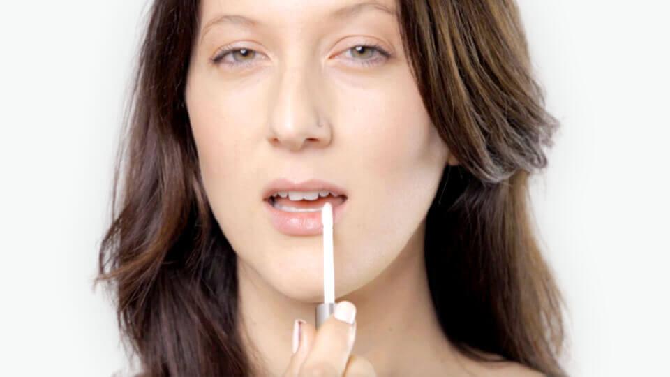 woman applying Sublime Lips