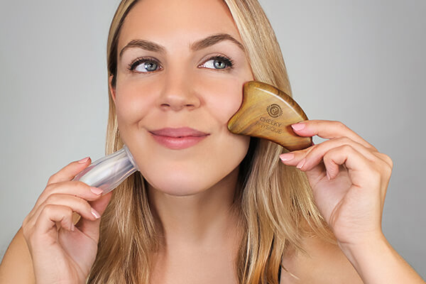 woman with skincare tools